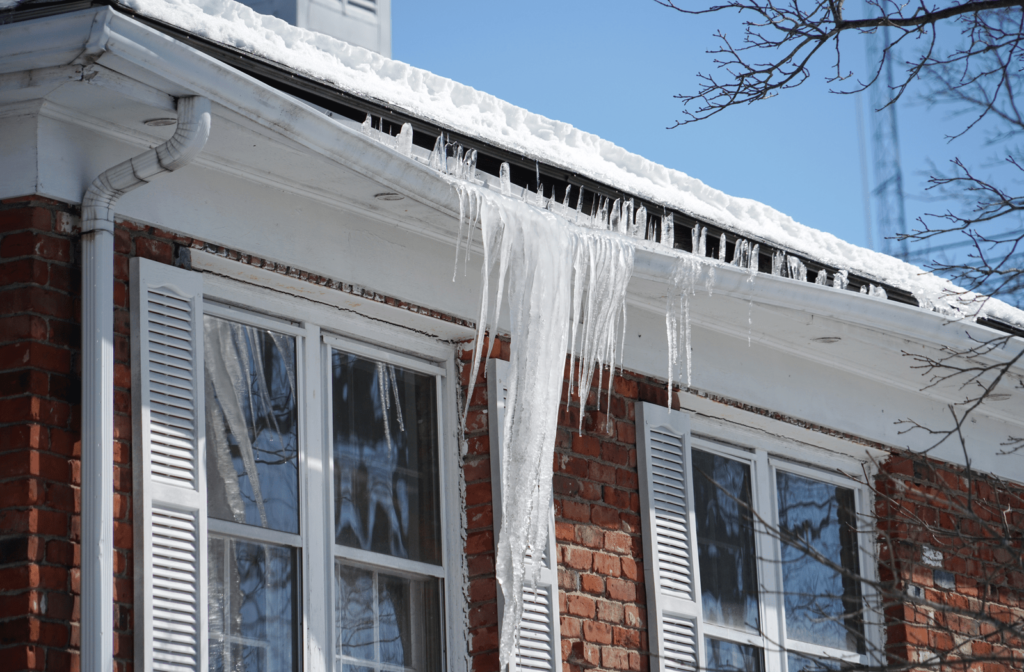 Ice dam forming on roof of house and pulling down gutter