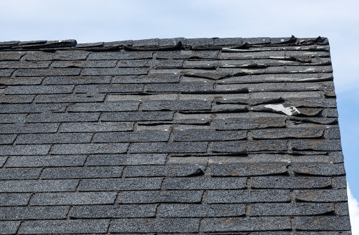An older roof in need of a replacement for old damaged shingles