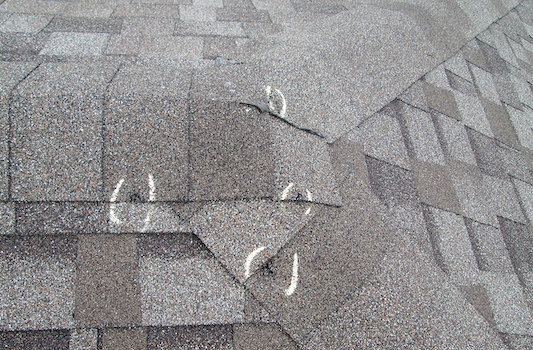 Hail damaged roof by hail inspection with identified damaged spots.